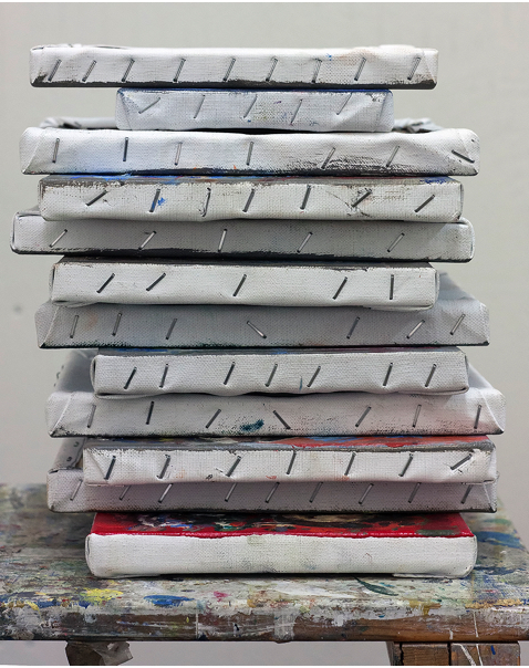 a pile of paintings
